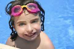 Beautiful little girl smiling in   pool Royalty Free Stock Photo
