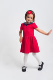 Beautiful little Girl smiling in red dress Stock Images