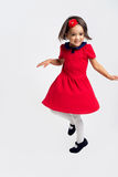 Beautiful little Girl smiling in red dress stock image