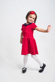 Beautiful little Girl smiling in red dress Stock Photos