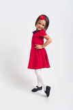 Beautiful little Girl smiling in red dress Royalty Free Stock Photography