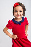 Beautiful little Girl smiling in red dress Royalty Free Stock Image