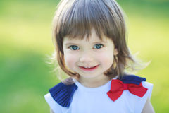 Beautiful little girl smiling. On a sunny day Royalty Free Stock Photos