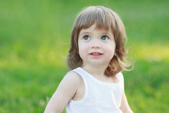 Beautiful little girl smiling. On a sunny day Royalty Free Stock Images