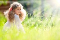 Beautiful little girl smiling and walking in field Stock Photos
