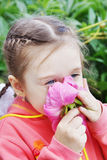 Beautiful Little Girl Sniffs Large Peony Flower Royalty Free Stock Photos