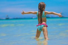 Beautiful little girl spread her arms standing at Stock Photo