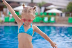 Beautiful little girl spread her arms standing Stock Photography