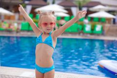 Beautiful little girl spread her arms standing Royalty Free Stock Photos