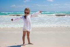 Beautiful little girl spread her arms standing at Royalty Free Stock Images