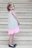 Beautiful little girl on the stairs in long dress Royalty Free Stock Image