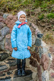 Beautiful little girl standing on the stone stairs Royalty Free Stock Photo