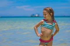 Beautiful little girl standing in water at the Royalty Free Stock Images