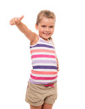 Beautiful little girl standing on white and showing OK sign Royalty Free Stock Images