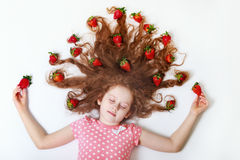 Beautiful little girl with Strawberry in her hair. Royalty Free Stock Photo