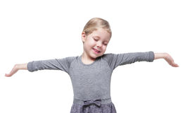 Beautiful little girl stretching her arms to wake up isolated Stock Photo