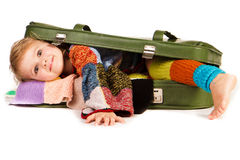Beautiful little girl in suitcase Royalty Free Stock Photography