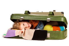 Beautiful little girl in suitcase Stock Image