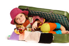Beautiful little girl in suitcase Stock Images