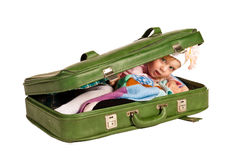 Beautiful little girl in suitcase Royalty Free Stock Photo
