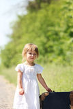 Beautiful little girl with a suitcase Royalty Free Stock Image