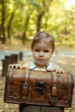 Beautiful little girl with suitcase Royalty Free Stock Photo