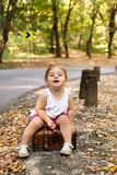 Beautiful little girl with suitcase Royalty Free Stock Photos