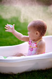 Beautiful little girl in the summer bathing with soap bubbles Royalty Free Stock Photos