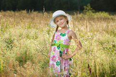 Beautiful little girl in a summer hat Royalty Free Stock Photography