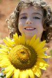 Beautiful little girl in a summer sunflower field Royalty Free Stock Photography