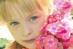 Beautiful little girl. Beautiful little girl in summer weather with Phlox flowers stock photography