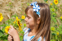 Beautiful little girl and sunflower Royalty Free Stock Image