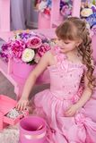 Beautiful little girl at a birthday party. stock photo