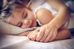 Beautiful little girl in sweet dream. Close up. Stock Image