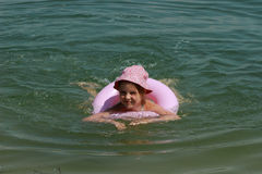 Beautiful little girl swimming Royalty Free Stock Image