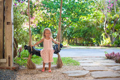 Beautiful little girl swinging on a swing in a Royalty Free Stock Photography