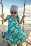 Beautiful little girl swinging on a swing outdoors. This image has attached release Stock Photos