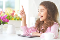 Beautiful little girl with tablet pc Stock Photos