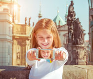Beautiful little girl taken pictures of her self. Czech Republic, Prague royalty free stock image