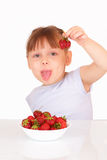 Beautiful little girl with tasty strawberries Royalty Free Stock Image