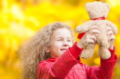 Beautiful little girl with teddy bear. Royalty Free Stock Photos