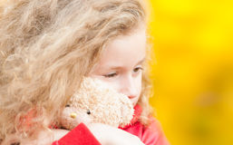 Beautiful little girl with teddy bear. Royalty Free Stock Images