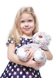 Beautiful little girl with teddy bear  Stock Photo