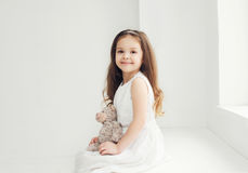 Beautiful little girl with teddy bear Stock Photography