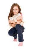 Beautiful little girl with a teddy elephant Royalty Free Stock Image