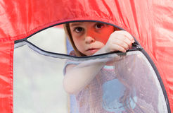 Beautiful little girl in a tent Stock Image