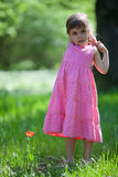 Beautiful little girl and tulip Stock Image