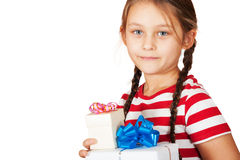 Beautiful little girl with two gifts Stock Photo