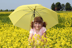 Beautiful little girl with umbrella Stock Photo