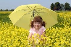 Beautiful little girl with umbrella Stock Photo